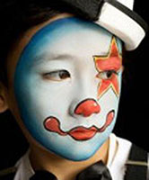 Child face painted for themed event