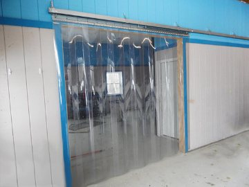 Rolling hardware for strip doors allows doors to bi part or slide completely to one side