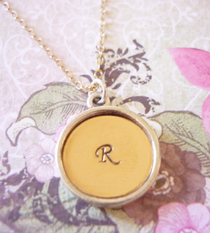 hand stamped silver and gold raised edge pendant
