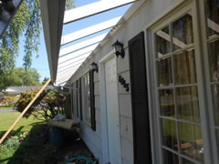 Removal of damaged plywood overhang due to use of too-long nails