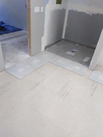 New bathroom tile floor installation