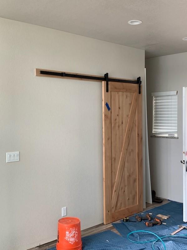 Barn Door leading to Bathroom in this Spokane remodel