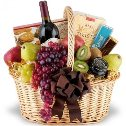 A classic basket filled with fresh fruit, gourmet, and wine.