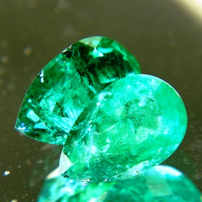 oil only zimbabwe emerald vivid green pear shape near 2 carat with matching sister pair