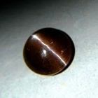 big five carat cabochon cat's eye with different ray colors in untreated natural from Sri Lanka with