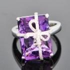 white gold and diamond bow around amethyst
