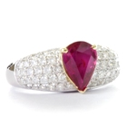 yellow and white gold and diamonds surrounding one and half carat carats unheated ruby