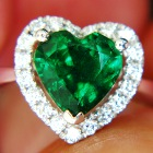 white gold and diamonds with two carat unoiled carats emerald