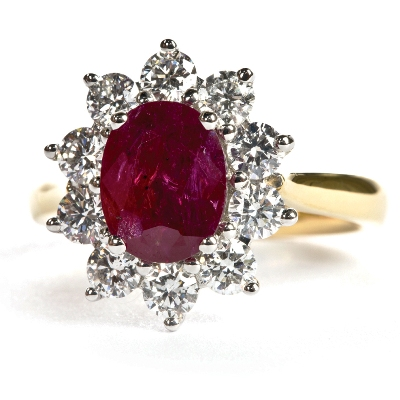 white and yellow gold and fine diamonds hold two carat unheated Burma ruby in vivid red oval