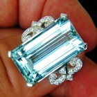 intense pool blue aquamarine of near thirty carats, untreated and lens clean in platinum