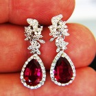 white gold and diamonds around three carats rubellite earrings