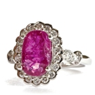 white gold and diamonds surrounding two carats unheated ruby