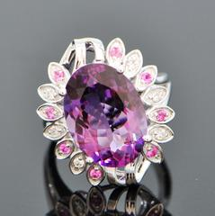 giant russian amethyst with diamonds and sapphires in cocktail ring