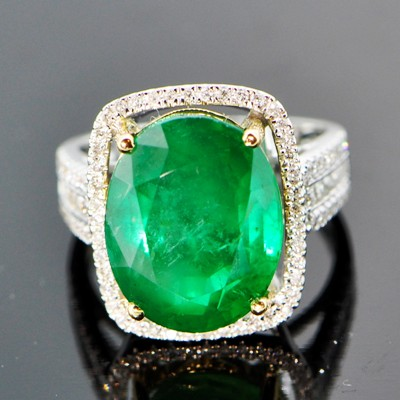white gold and diamonds with four carat unoiled carats Zambian emerald