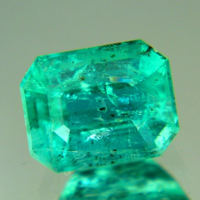 Sandawana oil-only emerald in emerald cut open blue-green
