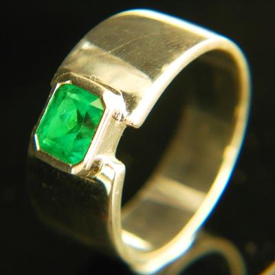 0.74 carat sandawana emerald in gold ring