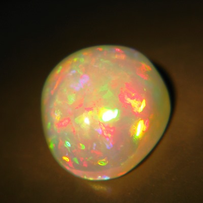 untreated rainbow colored white welo opal with video