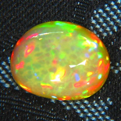 untreated neon rainbow colored welo opal in oval freeform