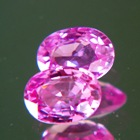 oval 7x5mm no-heat sapphires in hot pink for a pair of studs or sidestones