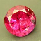 round rhodolite with IGI certificate deep red purple