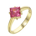 beautiful 18k yellow gold engagement ring with an natural not treated redish spinel