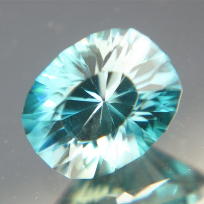 unheated blue-green zircon with white zones from Cambodia in precision cut