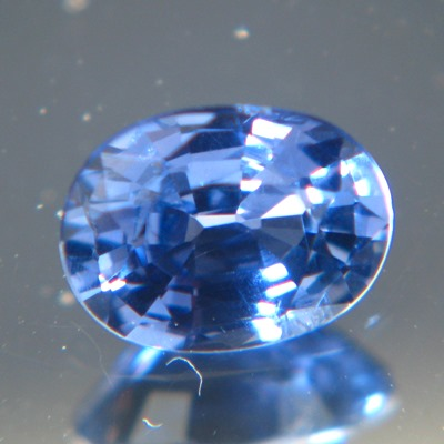 demin blue oval cut sapphire from Ceylon, unheated and natural, no window, IGI report