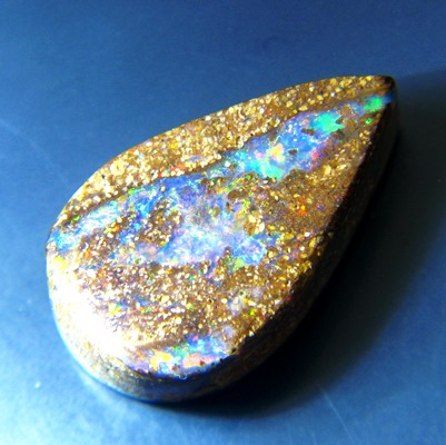 untreated all color neon welo opal in pear shape with broad flames