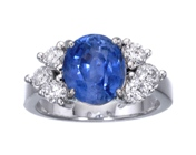 natural blue sapphire and six diamonds in a gold ring