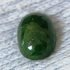 deep green tsavorite garnet in cabochon near three carats