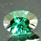 dark blue green Mozambique tourmaline concave cut