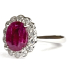 white gold and fine diamonds hold two carat unheated african oval ruby