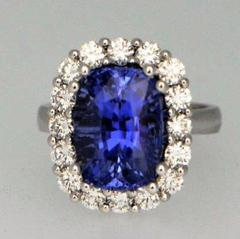 giant violet blue sapphire with 1.44 carat diamonds