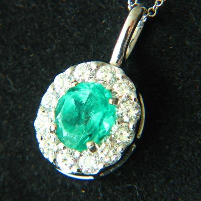 certified sandawana emerald in gold and diamonds