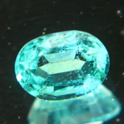 oval zambian one carat emerald with blue-green open clean crystal