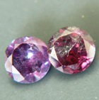 matching pair of certified alexandrites with 100 percent color-change