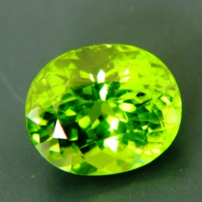 classic oval, best lime green pakistani peridot free of treatments over six carat