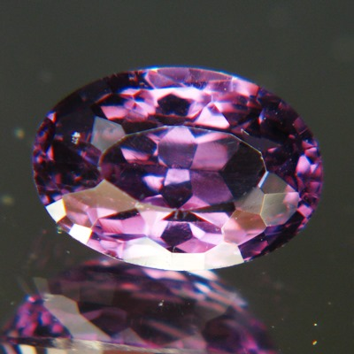 unheated pink-purple spinel from Ceylon, oval and dark deep cut