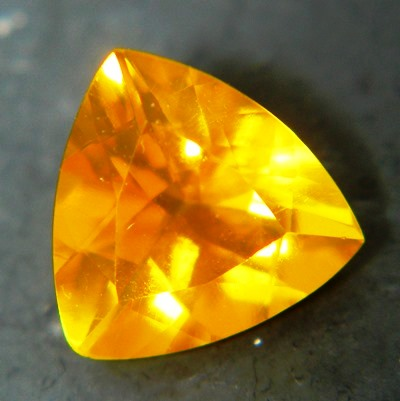 untreated faceted fire opal in trillion precision cut
