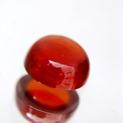 deep red orange hessonite garnet in round cabochon single