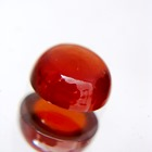 deep red orange hessonite garnet in round cabochon single