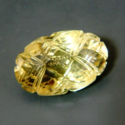 citrine without inclusions or treatments in oval cut and carved backside