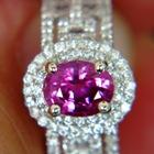 white gold and diamonds surrounding one carat clean  unheated Ceylon sapphire