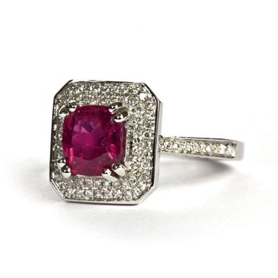 Shield of white gold diamonds hold two carat unheated burma ruby