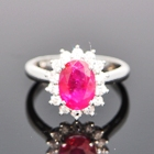 Shield of white gold diamonds hold two carat unheated burma ruby