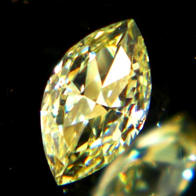 fancey yellow diamond in square cushion from Africa