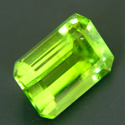 neon green pakistani peridot free of treatments, round and over 6 carat and 11mm