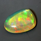 untreated yellow orange welo opal crystal with ribbon play