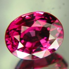oval rhodolite with certificate and finest berry color