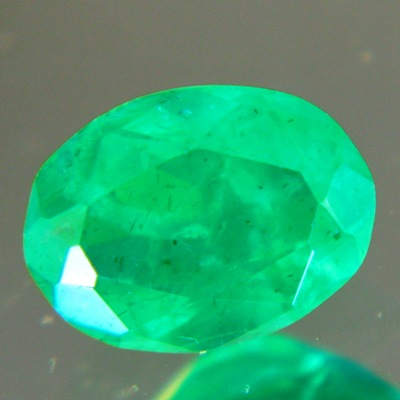 zimbabwe emerald oval fine color quality oil only 0.7 carat